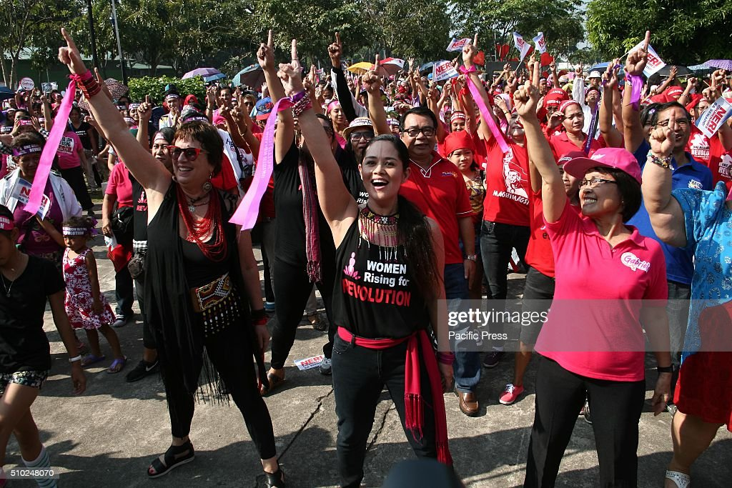 Eve Ensler (left) and Monique Wilson (center) lead the participants as they dance to the One Billion Rising theme song in Rizal Park, Manila. Hundreds flocked to Rizal Park, in Manila, to participate in the One Billion Rising event. Lead by Gabriela, a women rights group, activists danced as they campaign to end violence against women.