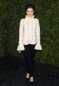 Eve Hewson attends the Chanel Charles Finch PreOscar Dinner held at Madeo Restaurant on March 1 2014 in Los Angeles California