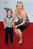 Eve Maren Buechner and son Jadon attend the 'Karate Kid' Germany Premiere at Sony Center Potsdamer Platz on July 19 2010 in Berlin Germany