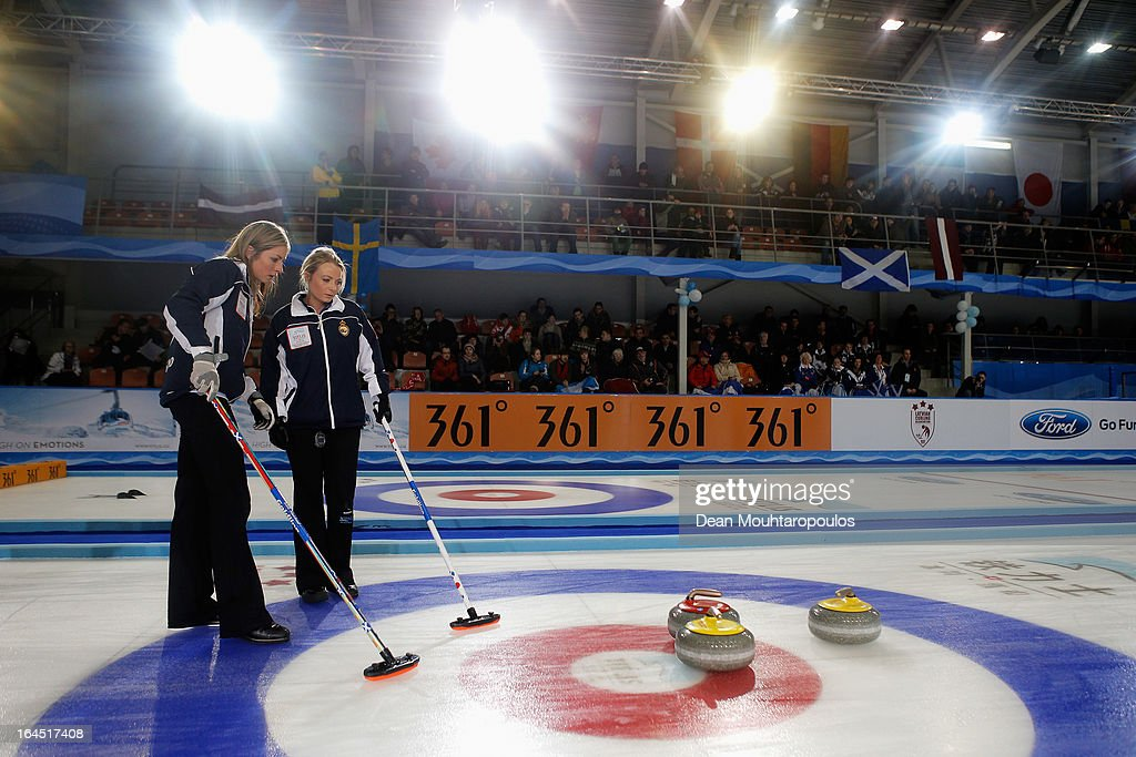 Eve Muirhead (L) and Anna Sloan of Scotland line up the final shot during the Gold medal match between Sweden and Scotland on Day 9 of the Titlis Glacier Mountain World Women's Curling Championship at the Volvo Sports Centre on March 24, 2013 in Riga, Latvia.