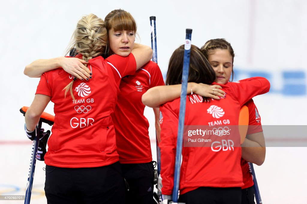 <a gi-track='captionPersonalityLinkClicked' href=/galleries/search?phrase=Eve+Muirhead&family=editorial&specificpeople=5635192 ng-click='$event.stopPropagation()'>Eve Muirhead</a>, <a gi-track='captionPersonalityLinkClicked' href=/galleries/search?phrase=Anna+Sloan&family=editorial&specificpeople=7577274 ng-click='$event.stopPropagation()'>Anna Sloan</a>, <a gi-track='captionPersonalityLinkClicked' href=/galleries/search?phrase=Vicki+Adams&family=editorial&specificpeople=9514303 ng-click='$event.stopPropagation()'>Vicki Adams</a>, and Claire Hamilton of Great Britain console each other after losing to Canada during the women's semifinal match between Great Britain and Canada at Ice Cube Curling Center on February 19, 2014 in Sochi, Russia.