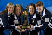Eve Muirhead Anna Sloan Vicki Adams and Claire Hamilton pose with the trophy after winning the Gold medal match between Sweden and Scotland on Day 9...