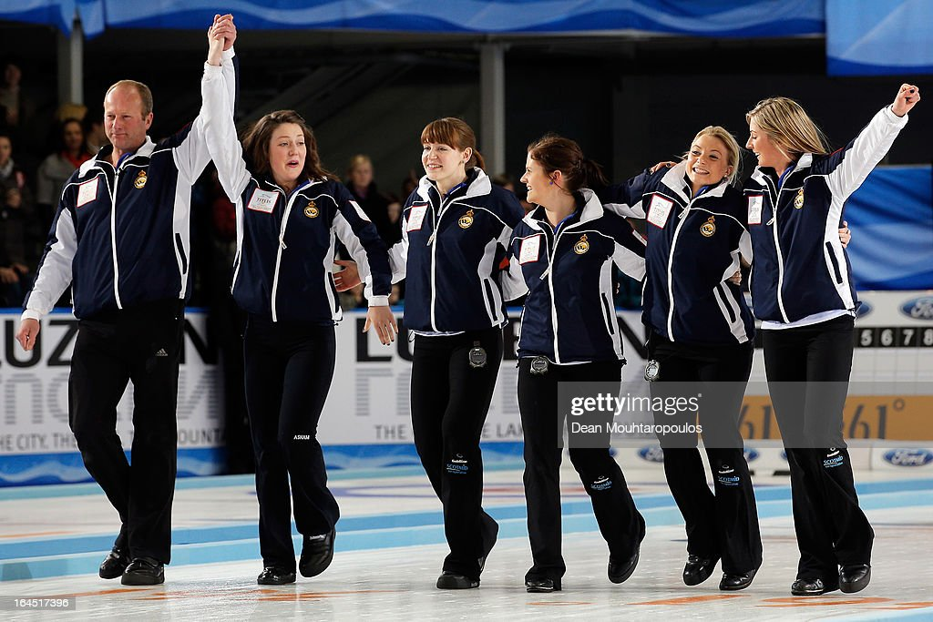 Eve Muirhead, Anna Sloan, Vicki Adams, Claire Hamilton, Lauren Gray and Coach, David Hay celebrate after winning the Gold medal match between Sweden and Scotland on Day 9 of the Titlis Glacier Mountain World Women's Curling Championship at the Volvo Sports Centre on March 24, 2013 in Riga, Latvia.