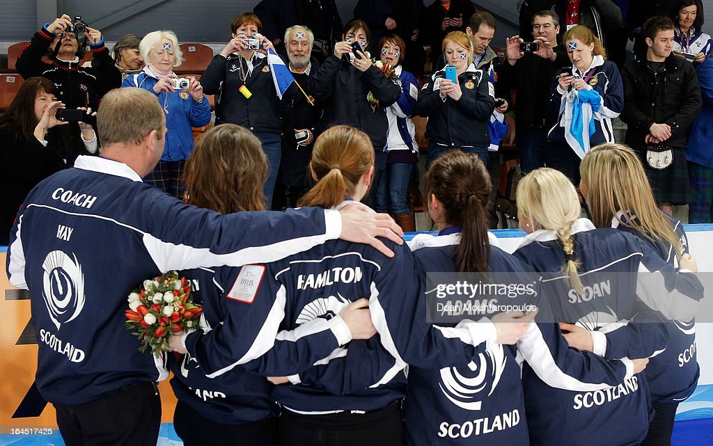 <a gi-track='captionPersonalityLinkClicked' href=/galleries/search?phrase=Eve+Muirhead&family=editorial&specificpeople=5635192 ng-click='$event.stopPropagation()'>Eve Muirhead</a>, Anna Sloan, Vicki Adams, Claire Hamilton, Lauren Gray and Coach, David Hay celebrate in front of the Scottish fans after winning the Gold medal match between Sweden and Scotland on Day 9 of the Titlis Glacier Mountain World Women's Curling Championship at the Volvo Sports Centre on March 24, 2013 in Riga, Latvia.