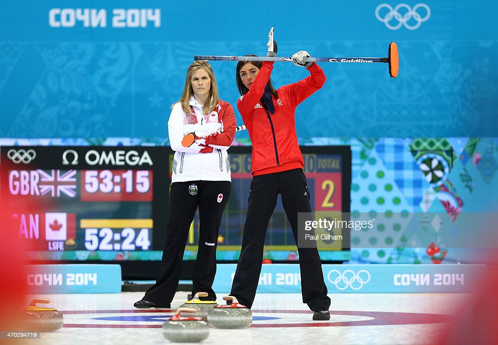Eve Muirhead of Great Britain signals to her teammates as Jennifer Jones of Canada looks on during the women's semifinal match between Great Britain...