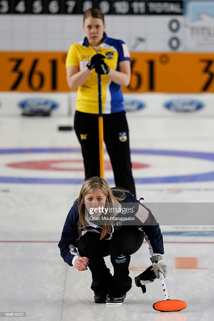 Eve Muirhead of Scotland screams instructions as Maria Wennerstrom of Sweden looks on during the Gold medal match between Sweden and Scotland on Day 9 of the Titlis Glacier Mountain World Women's Curling Championship at the Volvo Sports Centre on March 24, 2013 in Riga, Latvia.