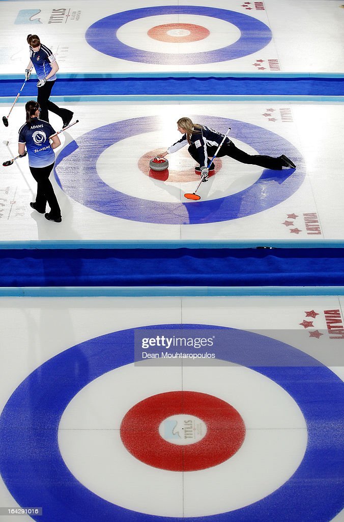 <a gi-track='captionPersonalityLinkClicked' href=/galleries/search?phrase=Eve+Muirhead&family=editorial&specificpeople=5635192 ng-click='$event.stopPropagation()'>Eve Muirhead</a> of Scotland throws a stone as Vicki Adams and Claire Hamilton get ready to sweep in the match between Scotland and Sweden on Day 7 of the Titlis Glacier Mountain World Women's Curling Championship at the Volvo Sports Centre on March 22, 2013 in Riga, Latvia.