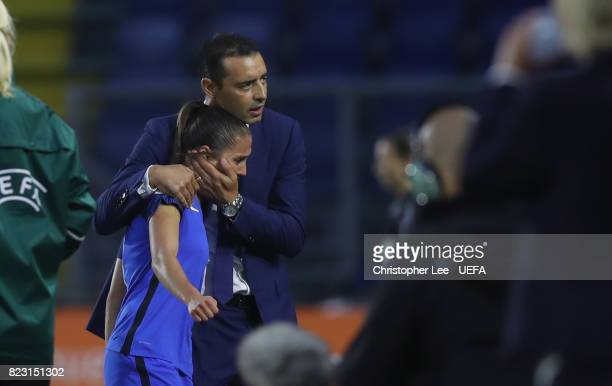 Eve Perisset of France is consoled by Olivier Echouafni head coach of France after she is sent off during the UEFA Women's Euro 2017 Group C match...