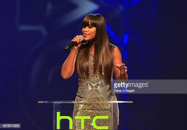 Eve presents an award onstage at the MOBO Awards at SSE Arena on October 22 2014 in London England