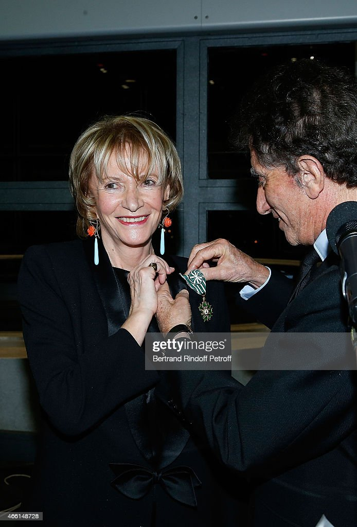 Eve Ruggieri and Jack Lang attend the Eve Ruggieri decorated Officier des Arts et Lettres by Jack Lang, President of Institut du Monde Arabe on March 13, 2015 in Paris, France.