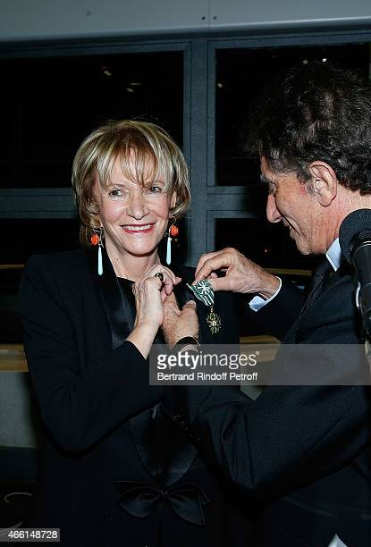 Eve Ruggieri and Jack Lang attend the Eve Ruggieri decorated Officier des Arts et Lettres by Jack Lang President of Institut du Monde Arabe on March...