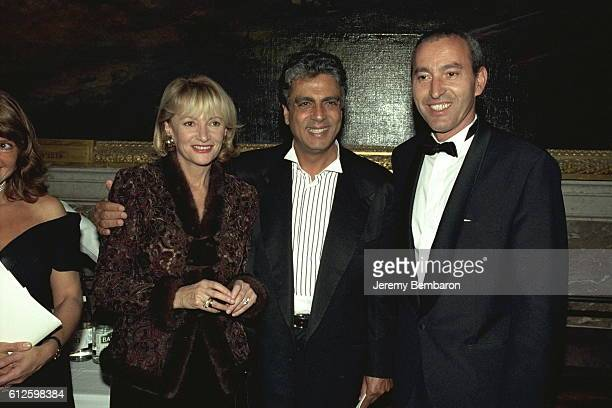 Eve Ruggieri Enrico Macias and Rachid Khimoun at the charity dinner in the Chateau of Versailles