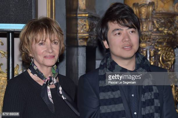 Eve Ruggieri poses with Musician Lang Lang of China during his Wax Work Unveiling celebration at Musee Grevin on May 5 2017 in Paris France