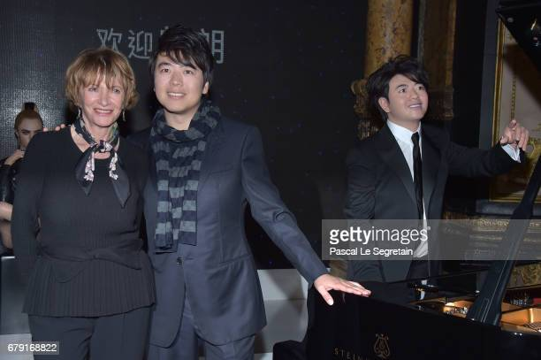 Eve Ruggieri poses with Musician Lang Lang of China next to his wax sculpture during his Wax Work Unveiling celebration at Musee Grevin on May 5 2017...