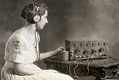 Evelyn C Lewis Miss Washington 1921 listens to the radio She tunes in by adjusting the condenser