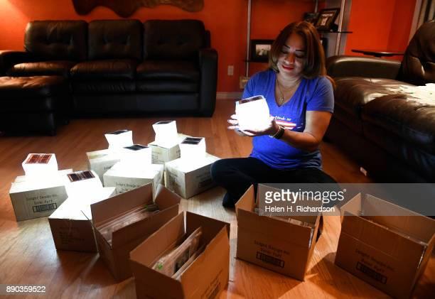 RIDGE CO DECEMBER 10 Evelyn CartagenaMeyer packs up solar lights in her living room on December 10 2017 in Wheat Ridge Colorado Evelyn is making her...
