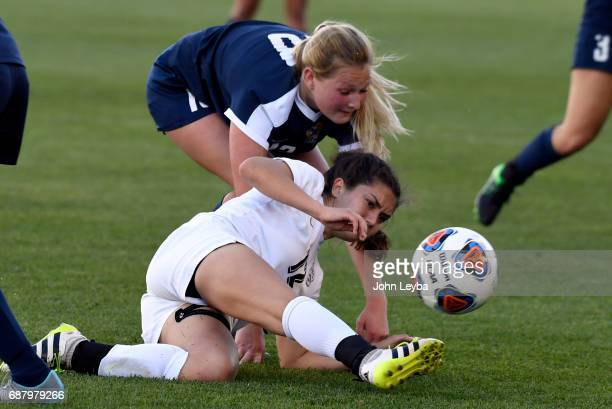 Evelyn Isabella Scaturro kicks the ball while on the ground and getting pressure from Evergreen Sydney Westgard in the second half during the 2017...
