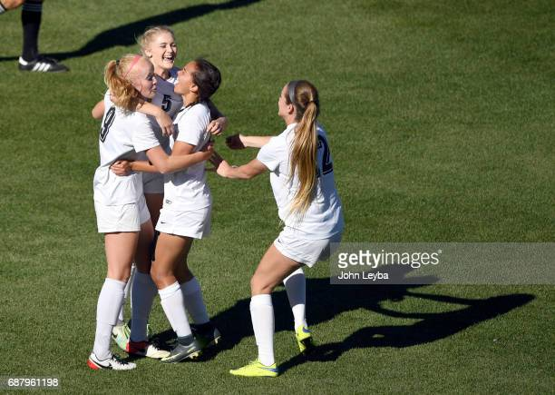 Evelyn Laryssa Hamblen celebrates her goal with D'Evelyn Shiloh Miller D'Evelyn Tianna Wright and D'Evelyn Hailee Lansville after scoring in the...