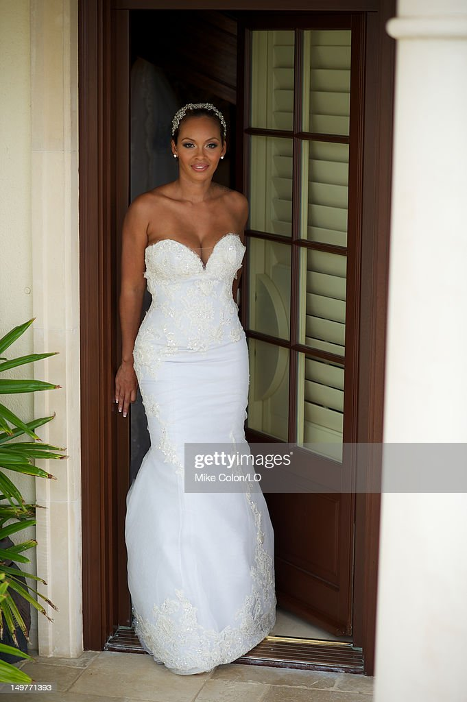 Evelyn Lozada poses for photos at her wedding to Chad Ochocinco at Le Chateau des Palmiers on July 4, 2012 in St. Maarten, Netherlands Antillies.