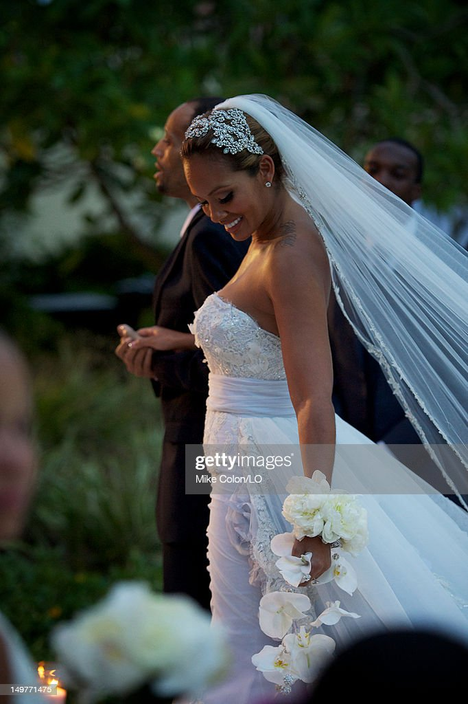 Evelyn Lozada walks down the aisle during her wedding to Chad Ochocinco at Le Chateau des Palmiers on July 4, 2012 in St. Maarten, Netherlands Antillies.