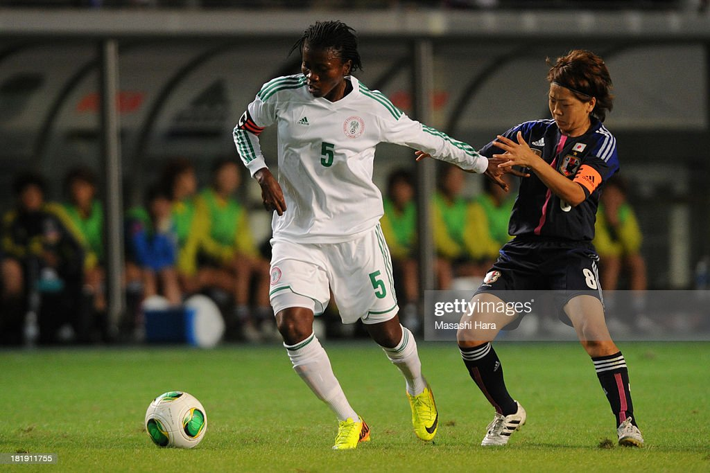 Evelyn Nwabuoku #5 of Nigeria and Aya Miyama #8 of Japan compete for the ball during the Women's international friendly match between Japan and Nigeria at Fukuda Denshi Arena on September 26, 2013 in Chiba, Japan.