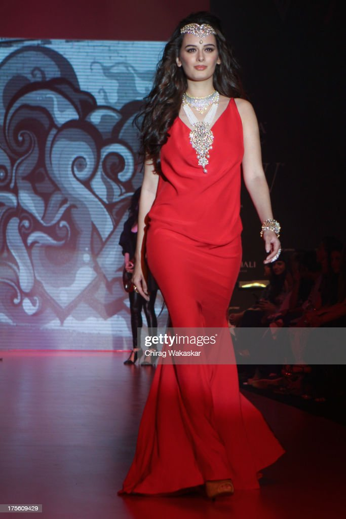 Evelyn Sharma walks the runway in an Gehna design on day 1 of India International Jewellery Week 2013 at the Hotel Grand Hyatt on August 4, 2013 in Mumbai, India.