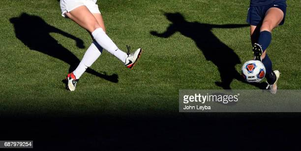Evelyn Shiloh Miller kicks the ball past the foot of Evergreen Alex Mason in the second half during the 2017 CHSAA Girls Soccer State Championship...