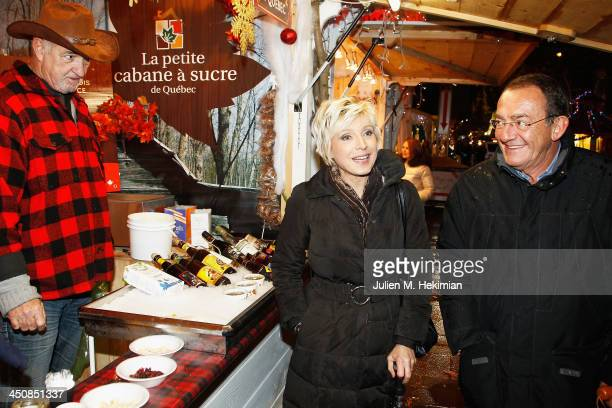 Evelyne Dheliat and Jean Pierre Pernaut launch the Paris Christmas illuminations at the ChampsÉlysées on November 20 2013 in Paris France