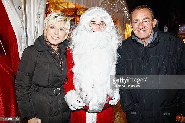 Evelyne Dheliat and Jean Pierre Pernaut pose with Father Christmas at the launch the Paris Christmas illuminations at the ChampsÉlysées on November...