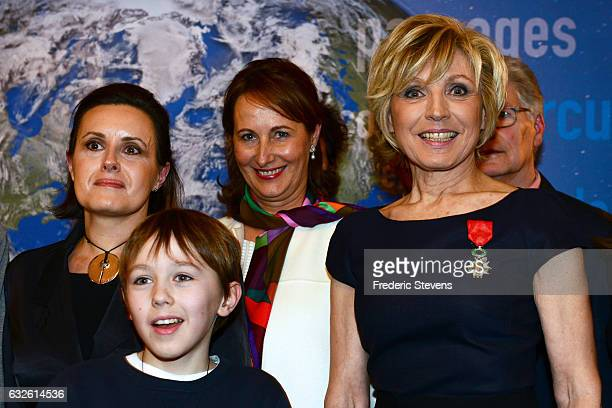 Evelyne Dheliat pose with her daughter and grandson afterreceiving the French Legion of Honor by Segolene Royal at the France Minister of Ecology on...
