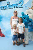 EveMaren Buechner with Children Jack and Max attend the 'Die Schluempfe 2' Germany Premiere at Sony Centre on July 28 2013 in Berlin Germany