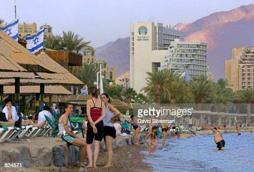 Even as evening draws near tourists enjoy one of the many beaches in the southern Israeli city of Eilat May 4 beaches which in previous years were...