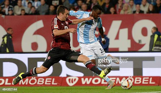 Even Hovland of Nuernberg challenges Stephane Mvibudulu of Muenchen during the second Bundesliga match between 1 FC Nuernberg and TSV 1860 Muenchen...