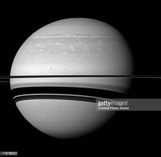 Even in a peaceful looking scene such as this one of Saturn and its moon Tethys the Cassini spacecraft reveals clues about how Saturn is everchanging