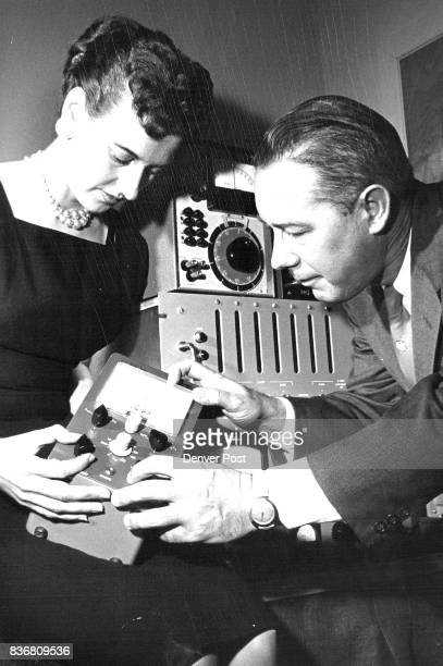 Even the secretary must know her electronics so Allen Williams explains a transistortester to Burnie Stewart Credit Denver Post
