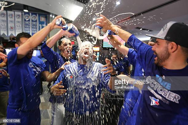 TORONTO ON SEPTEMBER 26 Even the team chef wasn't safe from a beer shower as the playoff bound Toronto Blue Jays celebrate in their clubhouse after...