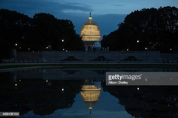 Evening arrives at the Capitol building covered in scaffolding for major repairs on Capitol Hill in Washington DC Today's elections will decide which...
