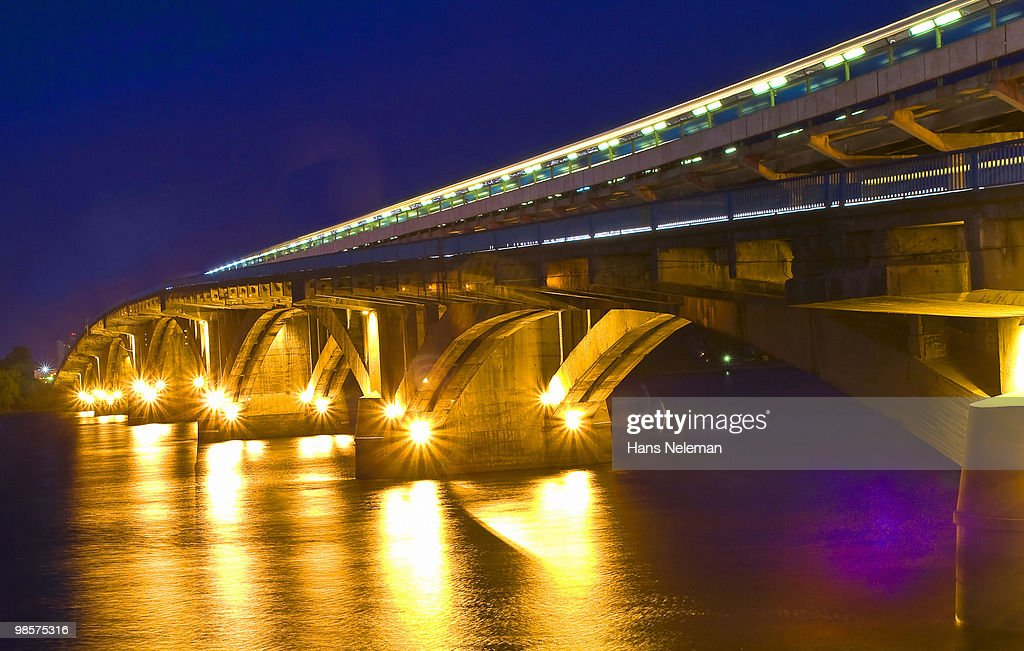 Evening bridge of 'Metro' across the river Dnepr. : Stock Photo