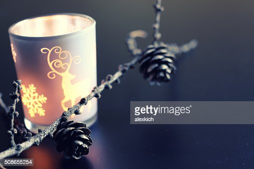 evening candle in glass fir-cone : Stock Photo