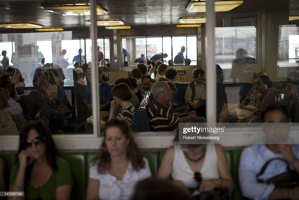 Evening commuters leaving New York City sit on the Staten Island Ferry June 20, 2012 on their way to Staten Island's St. George Terminal. The ride takes 25-minutes and the boat carries 21 million passengers annually.