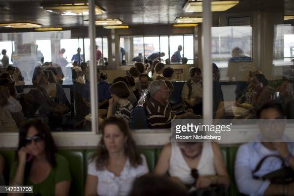 Evening commuters leaving New York City sit on the Staten Island Ferry June 20 2012 on their way to Staten Island's St George Terminal The ride takes...