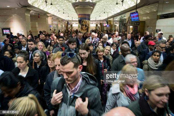 Evening commuters make their way toward a New Jersey Transit train platform at Penn Station April 4 2017 in New York City New Jersey Transit Amtrak...