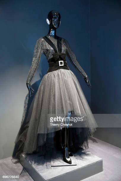 Evening dress in tulle and velvet bodice and sleeves embroidered with sequins is displayed during the exhibition 'Hubert de Givenchy' at 'Cite de la...