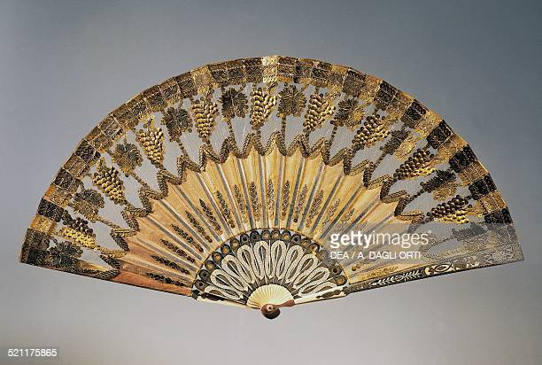 Evening hand fan decorated with motifs of bunches of grapes silk leaf gilded copper applications 1800 Spain 19th century Trieste Civico Museo...