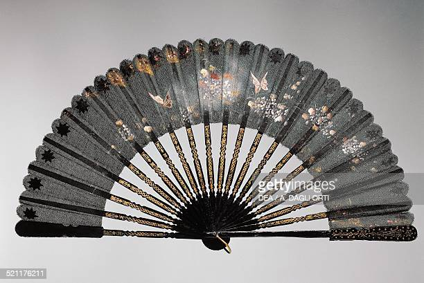 Evening hand fan with flowers and butterflies painted canvas leaf and gilded wooden ribs ca 1920 Spain 20th century Spain
