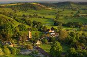 Evening spring sunshine looking down on Corton Denham, Somerset, UK