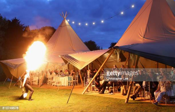 Evening performers dance with fire during the Arabian Nights party after Day Two of the Dubai Duty Free Irish Open at Portstewart Golf Club on July 7...