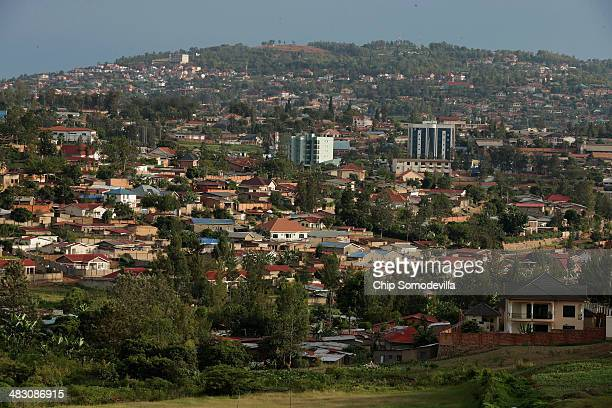 Evening sun falls over the Kicukiro District of the capital April 5 2014 in Kigali Rwanda Built in hilly country in the heart of the African...