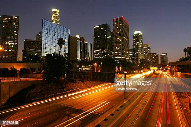 Evening traffic passes downtown highrises along the 110 freeway on June 13 2004 in Los Angeles California
