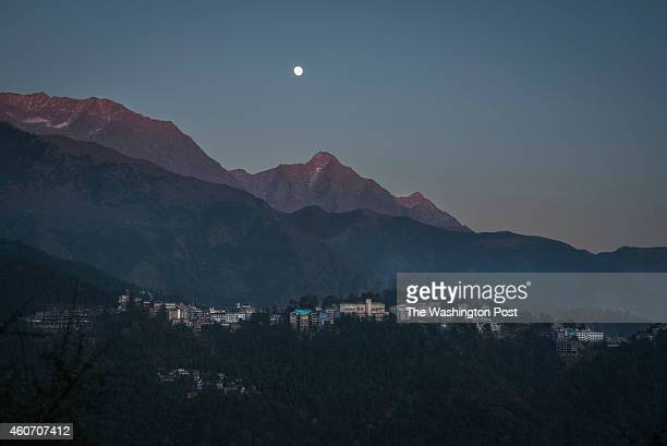 A evening view of McLeod Ganj under the slopes of the Dauladhar range of the Himalayas Dharamshala Himachal PradeshIndia